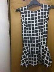 Black and white checkered peplum top